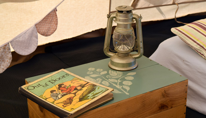 Old Bidlake Bell Tent Camping Dorset Campsite Bell Tents - Reading at Bedtime